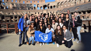 Photo of students in the Roman Colosseum