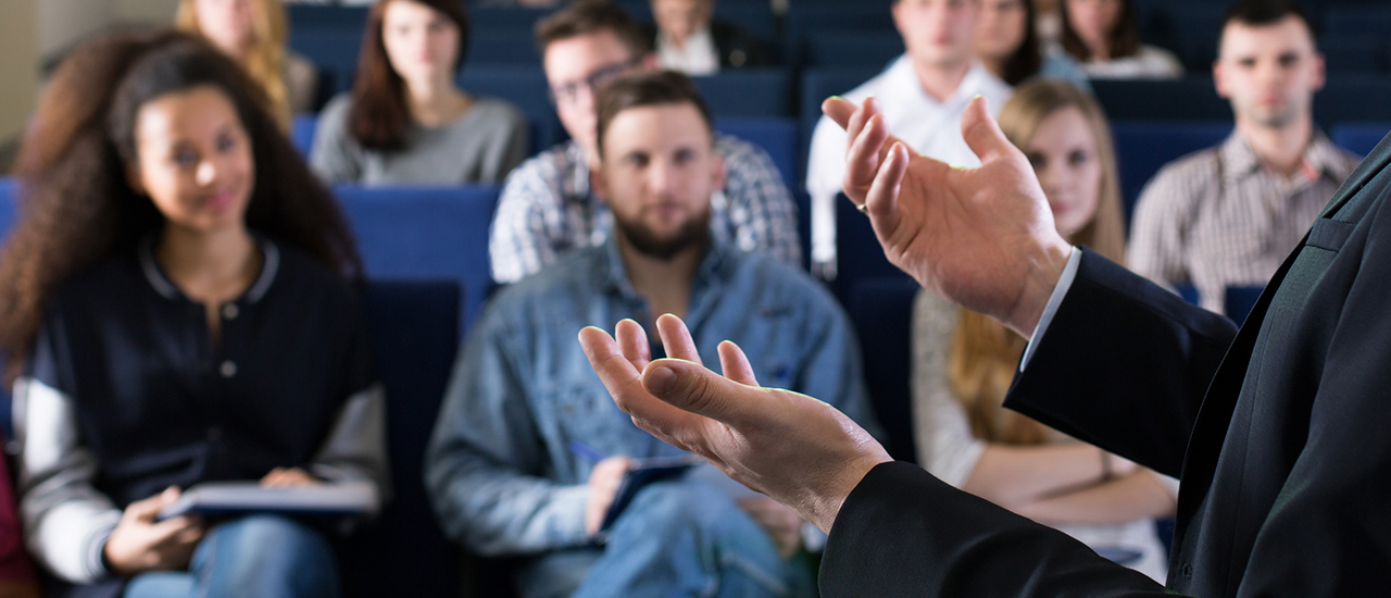 Man giving a lecture to an audience