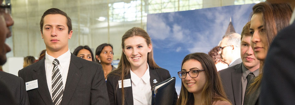 Seton Hall Students speak with an Employeer at Career Fair