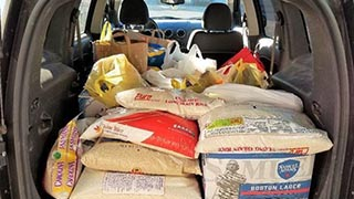 Food loaded in car during WSOU food drive collection