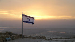 Flag of Israel waving in wind