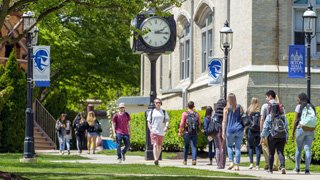 Students walking on path to class between Mooney and Stafford Hall